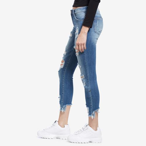 Left Side view of Woman wearing Cello Brand Distressed Crop Frayed Hem Skinny Jeans